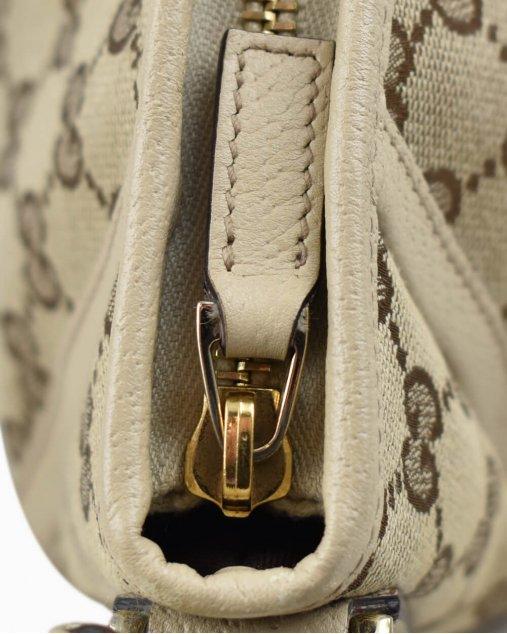 Bolsa Gucci Pochette Monograma