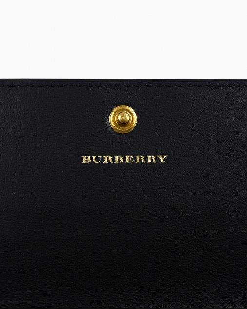 Carteira Burberry one flap com xadrez vintage